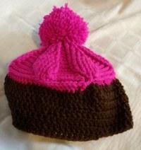 Erinnert mich ein bisschen an einen Schokocupcake mit rosa Topping
